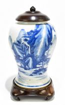 A 18th century Chinese Export blue and white vase with associated cover and stand decorated with