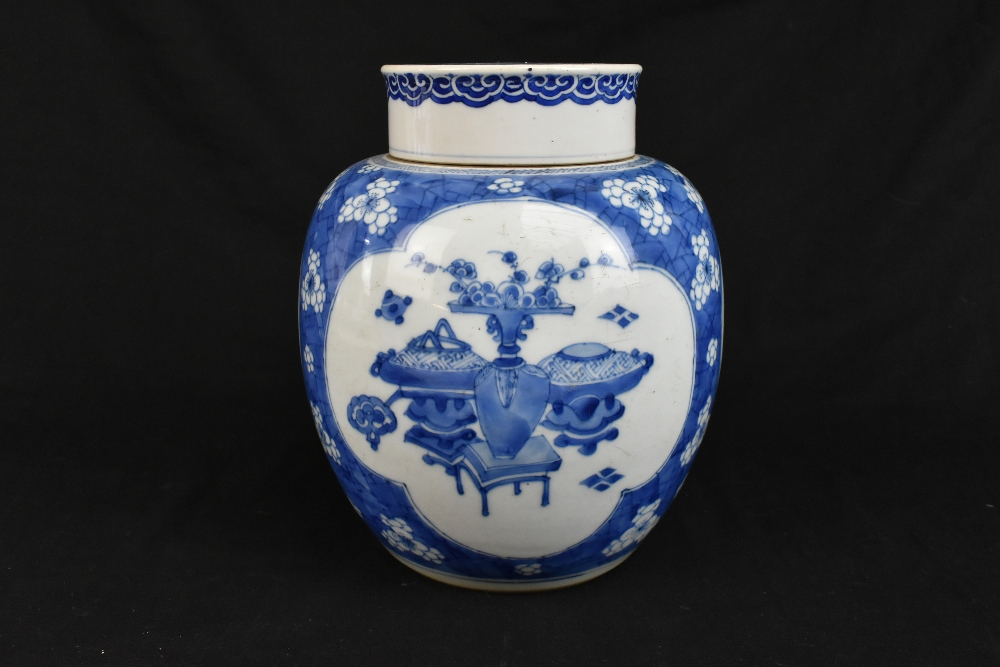A late 19th century Chinese blue and white ginger jar and cover, the cover painted with a shishi - Image 2 of 10