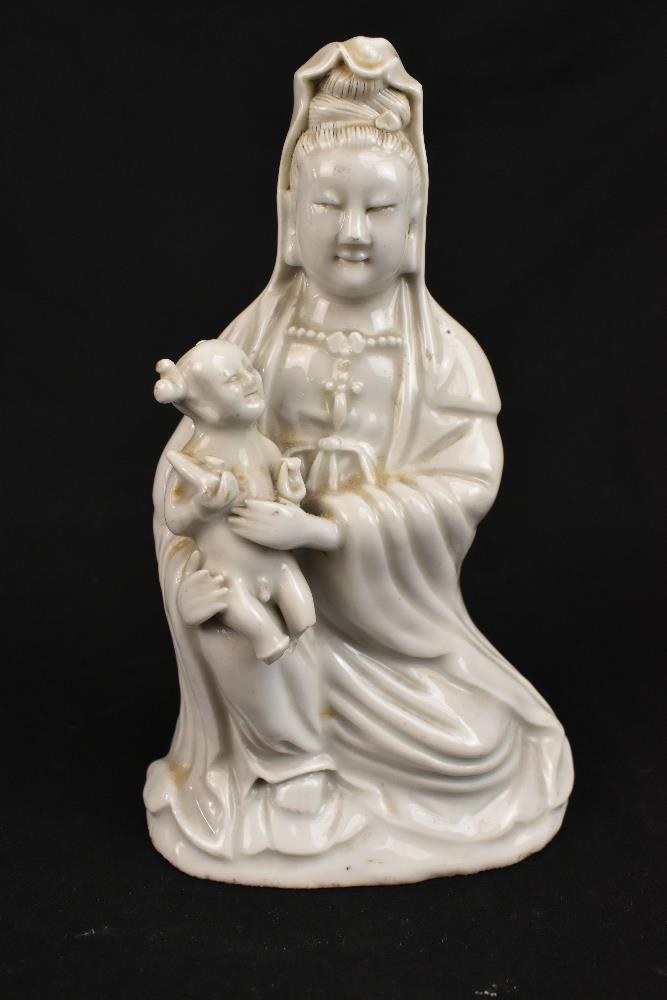 Two 19th century Chinese Blanc de Chine figures of Guan Ying including an example holding a child, - Image 2 of 11