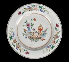 An 18th century Chinese porcelain Famille Rose wall charger decorated with objects to the centre