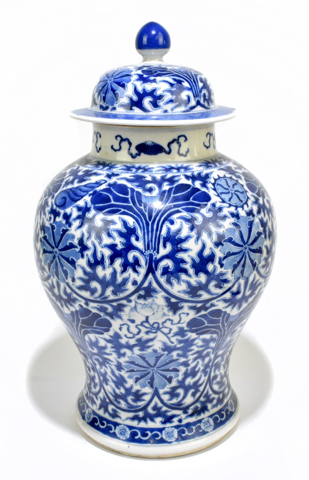 A late 19th century Chinese blue and white porcelain temple jar and cover, the top rim painted