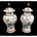 A pair of early 20th century Chinese porcelain Famille Rose temple jars and covers painted with