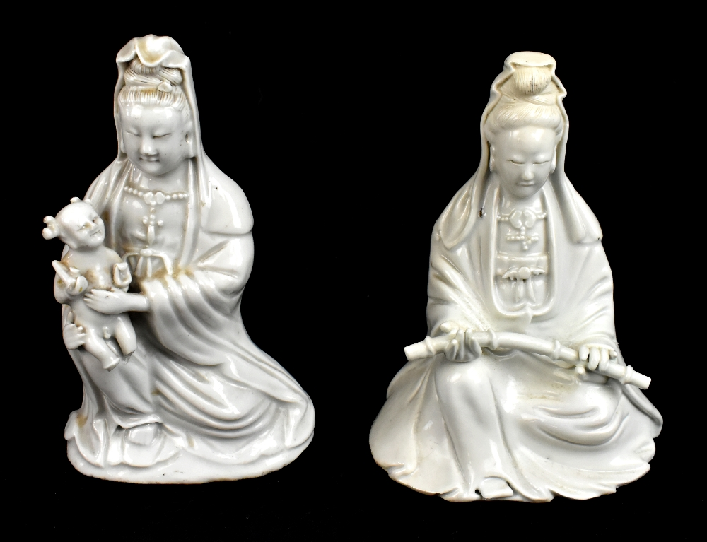 Two 19th century Chinese Blanc de Chine figures of Guan Ying including an example holding a child,