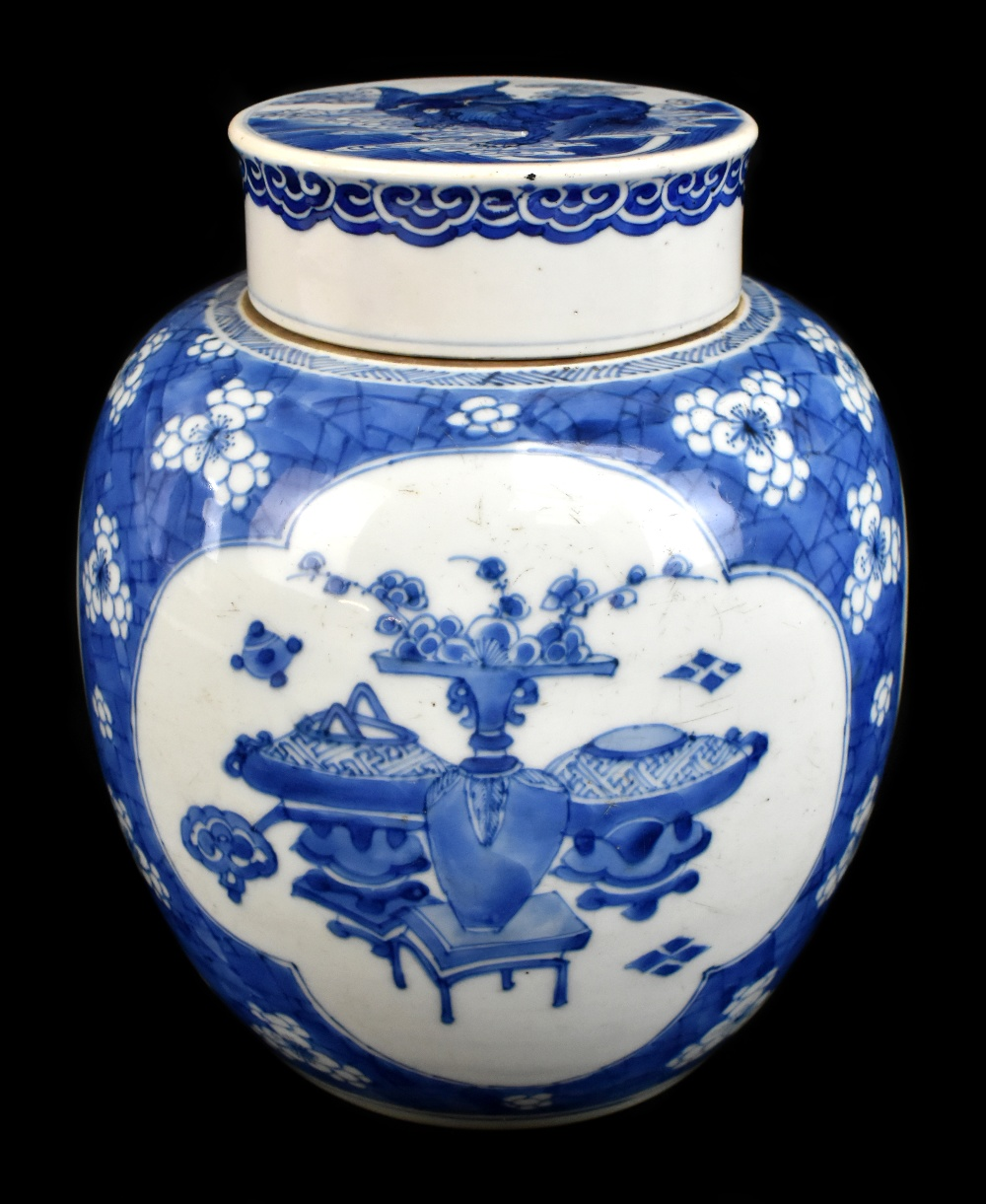 A late 19th century Chinese blue and white ginger jar and cover, the cover painted with a shishi