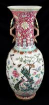 A large 19th century Chinese porcelain twin handled Famille Rose vase with flared neck with