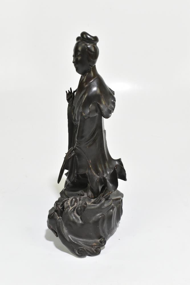 A 19th century Chinese porcelain figure representing Guan Ying standing on a mythical creature, - Image 5 of 6