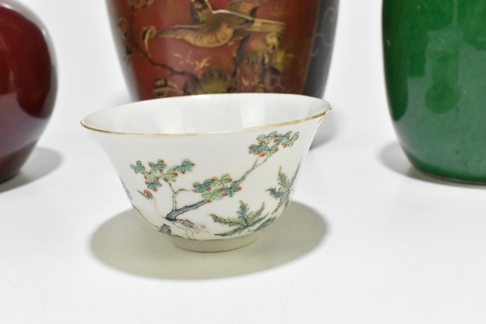 A Chinese Famille Rose porcelain footed tea bowl decorated with deer and exotic birds in - Image 4 of 18