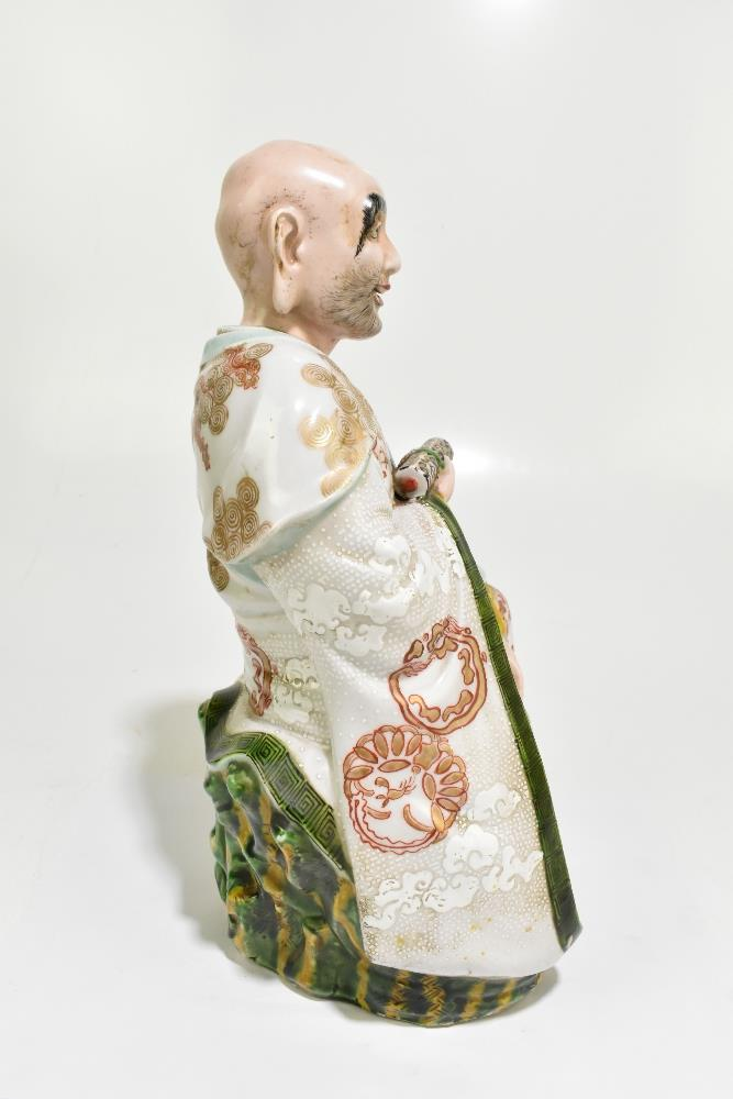 A late 19th century Chinese figure representing a seated scholar wearing a gown with relief and - Image 4 of 7