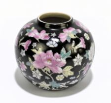 A 20th century Chinese Famile Noir porcelain vase of bulbous form, decorated in enamels with printed