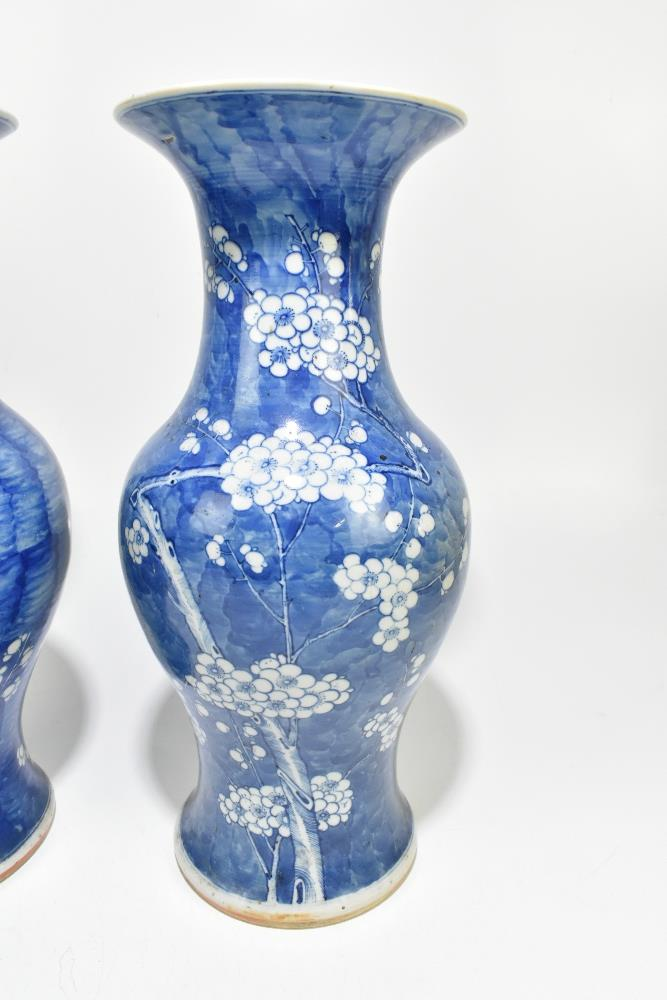 A near pair of 19th century Chinese blue and white porcelain vases decorated with prunus flowers - Image 3 of 12