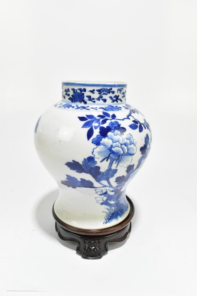 A late 19th century Chinese blue and white porcelain jar decorated with exotic birds perching beside - Image 2 of 7
