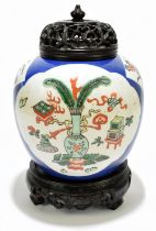 A late 19th century Chinese Famille Verte Wucai porcelain ginger jar with associated carved wooden