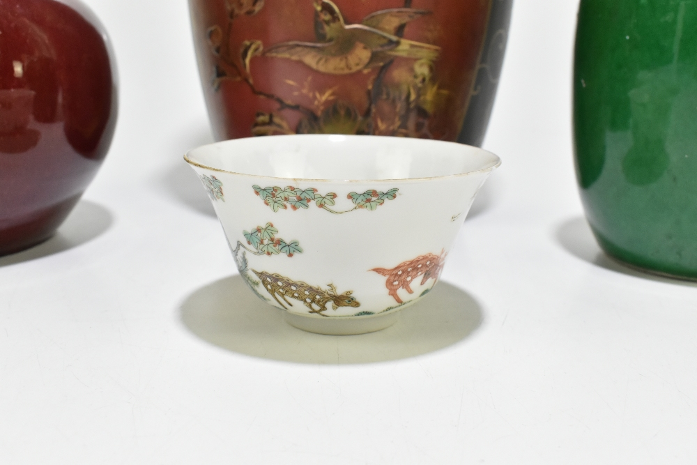 A Chinese Famille Rose porcelain footed tea bowl decorated with deer and exotic birds in - Image 2 of 18