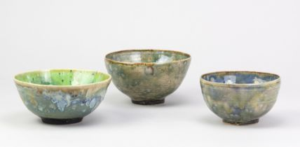 ANDREW CHAMBERS; a group of three stoneware bowls, green and blue glazes, one with decals of