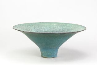 ABDO NAGI (1941-2001); a large stoneware pedestal bowl covered in mottled turquoise/green glaze with