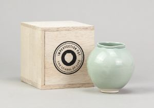 ADAM BUICK (born 1978); 'The Imperfection Pot', a miniature porcelain moon jar covered in celadon