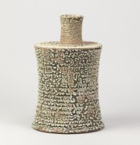 ANDREW PALIN (born 1969); a waisted stoneware bottle with off centre neck covered in crawling pale