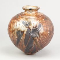 ALEX SHIMWELL (born 1980); a stoneware jar covered in shino and ash glaze, side fired on shells,