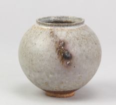 ADAM BUICK (born 1978); a miniature stoneware moon jar covered in grey glaze with iron decoration,