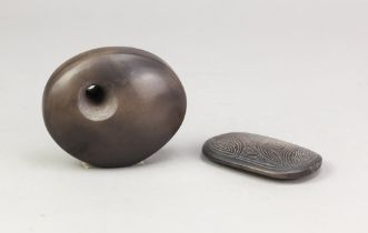 ANTONIA SALMON (born 1959); a small smoke fired stoneware pierced oval form, burnished with