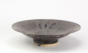 ABDO NAGI (1941-2001); a large stoneware bowl covered in metallic bronze glaze with dabs of pink
