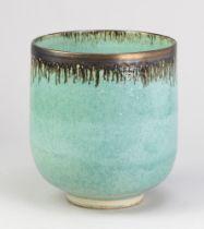 ABDO NAGI (1941-2001); a deep stoneware vessel covered in glossy turquoise glaze with bronze rim