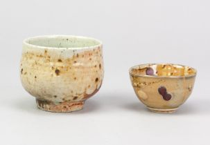 ANDY PRIESTMAN; a wood fired porcelain bowl partially covered in shino glaze, impressed mark,