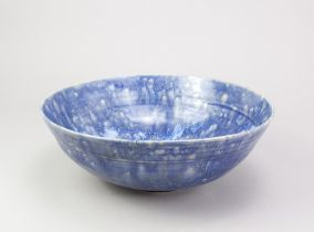 ANDREW CHAMBERS; a large stoneware bowl covered in mottled blue and streaky white glaze, various