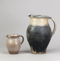 ALEX McERLAIN (born 1950); a large salt glaze jug with incised decoration, impressed AM mark, height