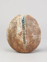 ALAN WALLWORK (1931- 2019); a stoneware split pebble with impressed decoration forming the parting
