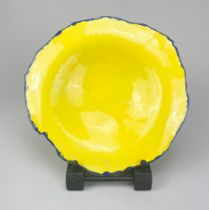 AILA SIMPSON; an earthenware slab dish covered in bright yellow glaze with cobalt rim, diameter
