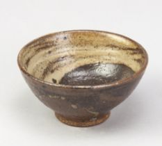 AKI MORIUCHI (born 1947); a small stoneware bowl with yin yang decoration to the well, impressed