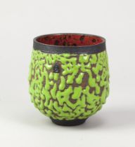 ANDREW PALIN (born 1969); a stoneware bowl with crawling green glaze to exterior and copper red