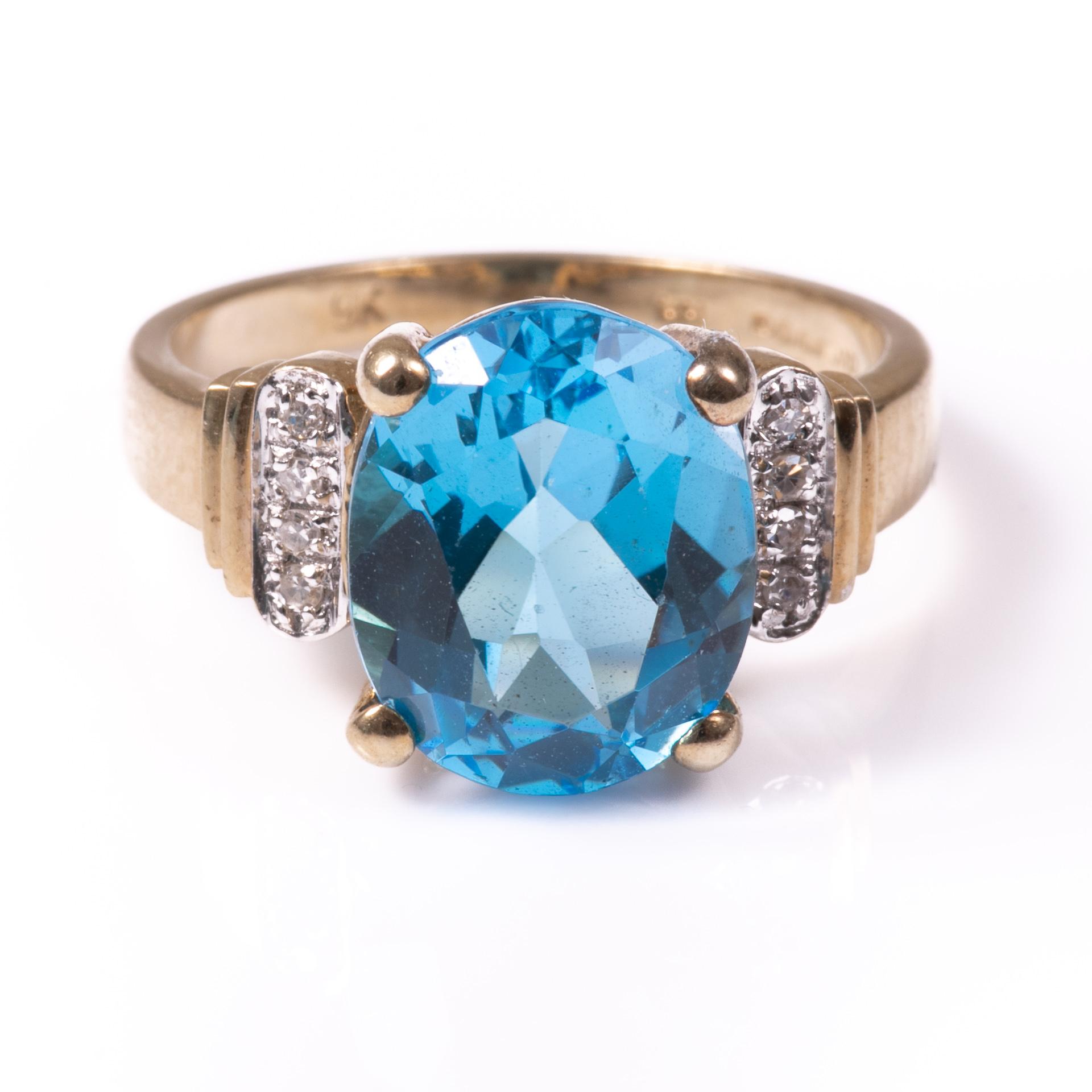 9ct Gold 4.40ct Blue Topaz & Diamond Ring
