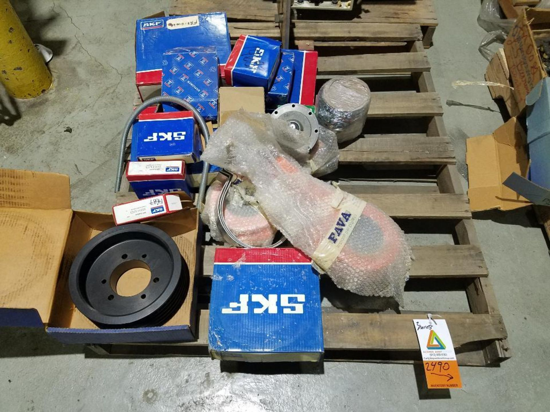 various replacement parts, chains, pulleys, gears, and sprockets