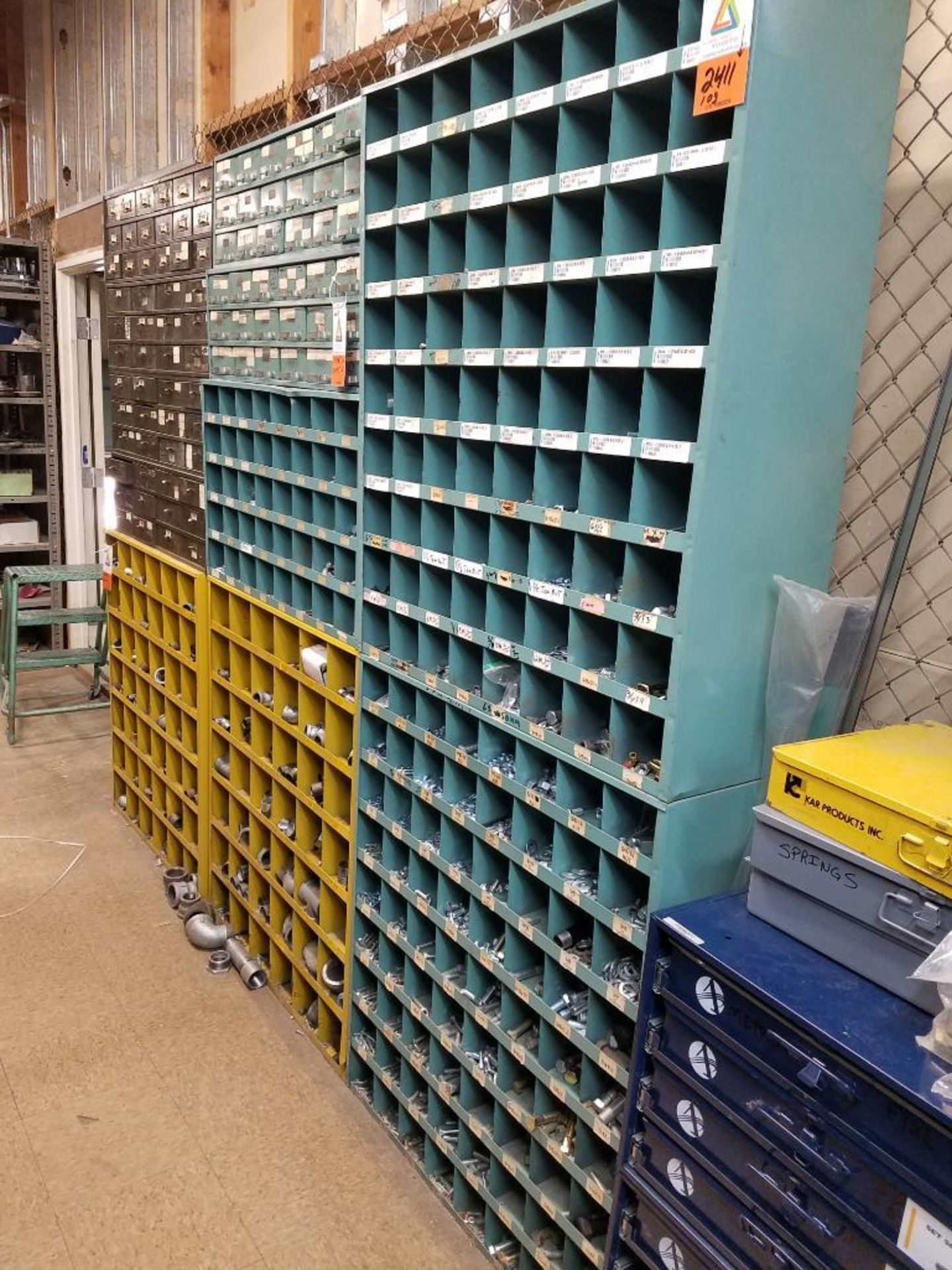 various nuts, bolts, screws, and pipes, storage units not included