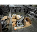pallet of new and used motors and drives