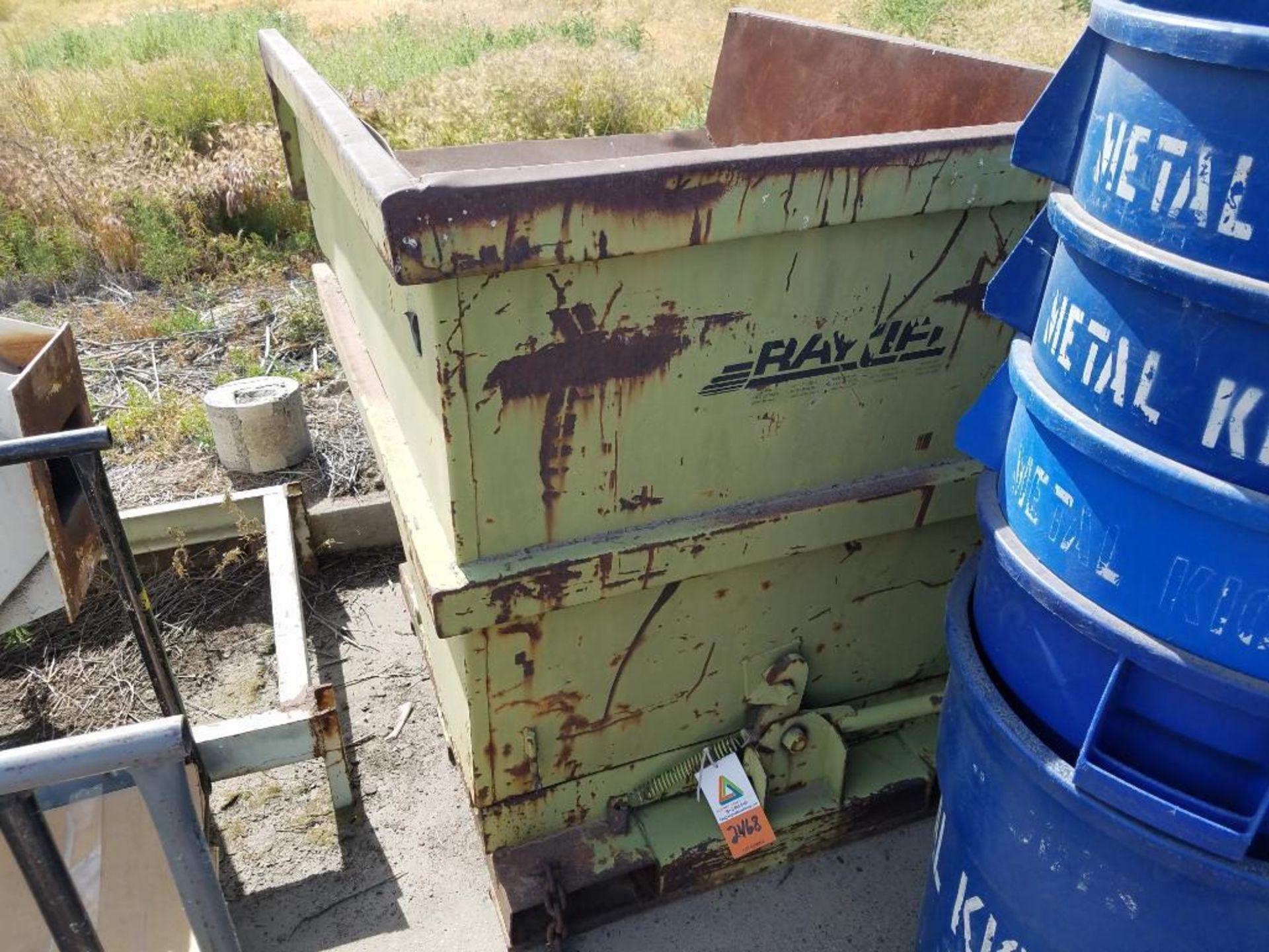 Raylift tilt dump hopper