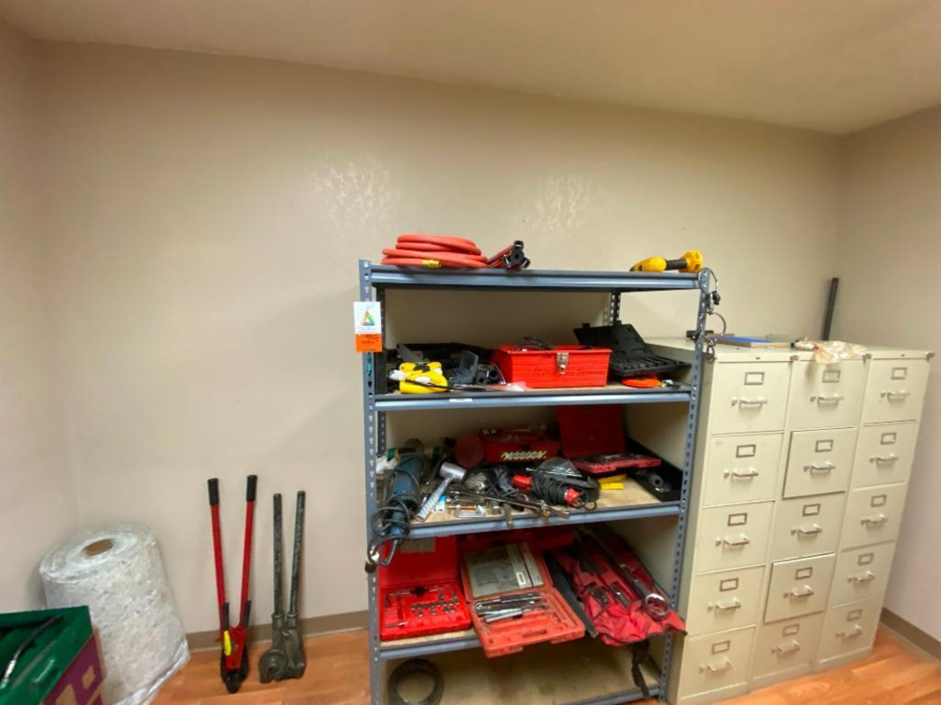 various tools includes bits, large wrenches, lockout tagout kit, grinder