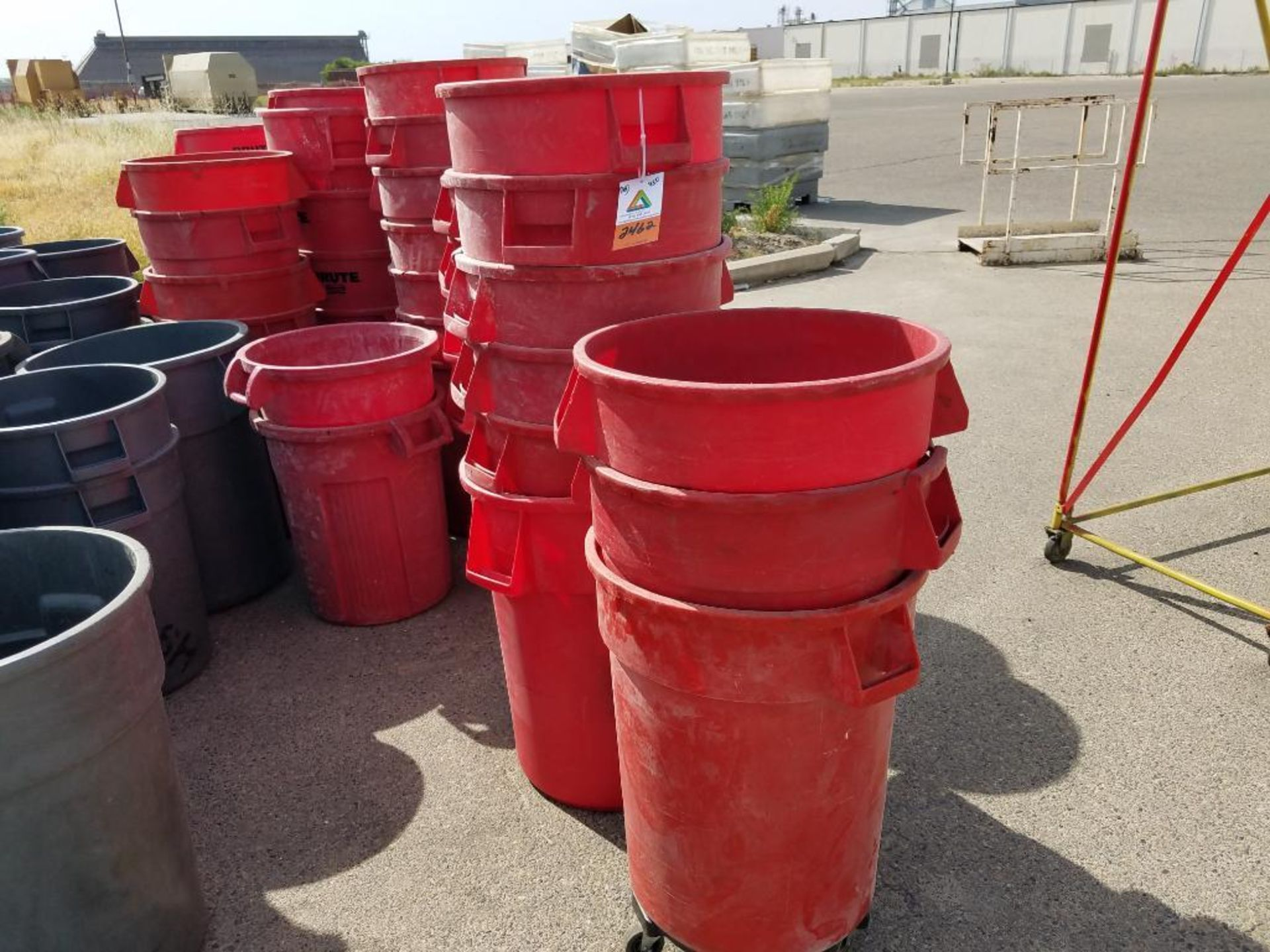 Brute red garbage cans