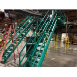 mild steel green mezzanine with two stairs and railing