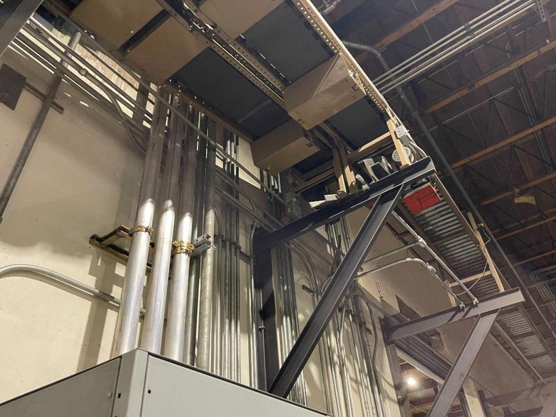 270 ft. of mild steel power roller and power belt overhead conveyor - Image 12 of 12
