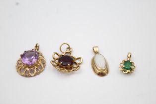4 x 9ct gold gemstone pendants inc amethyst, opal, garnet 4.6g