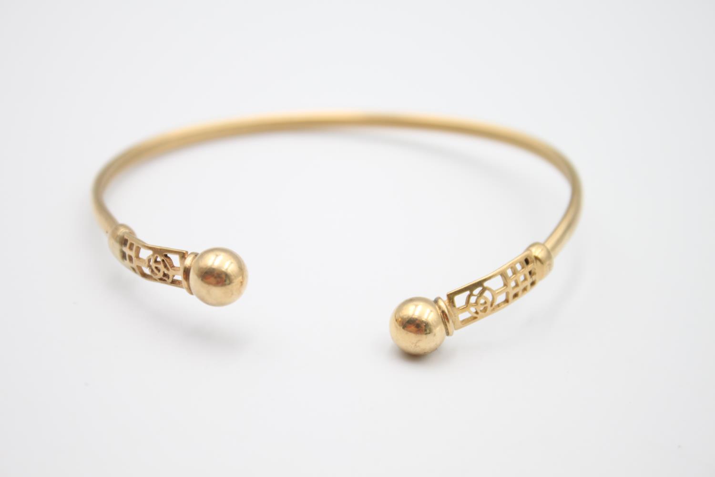 9ct gold Celtic rose design torque bangle 5.8g