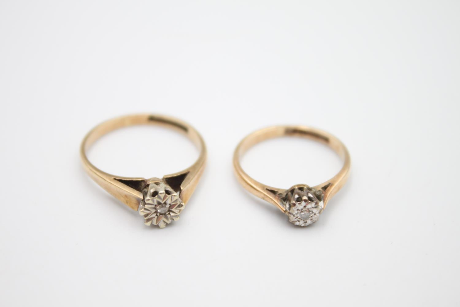 2 x 9ct gold diamond solitaire rings 3.6g Size M on left & H on right