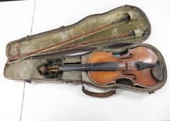 1 piece sarcophagus violin case containing early full sized violin with two bows - one bow marked