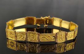 Bracelet, flexible links with various Christian symbols, 750/18K yellow gold, 41.7g, length 18cm