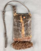 Small leather pull-out bag with narrow compartments, decorated underneath with a thick leather