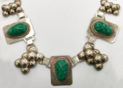 Designer necklace with aventurine, middle part with 5 hand engraved face masks of green aventurine