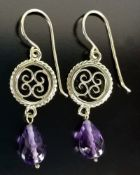 Antique gold earrings with amethyst, ear hooks with gold medallions in relief and suspended